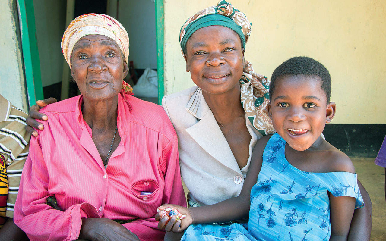 Grandmother, mother and daughter at the Bukumbi rehabilitation center, Tanzania