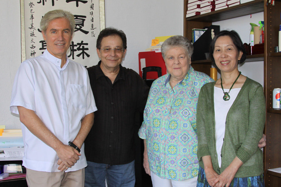 Advisory board (l. to r.) Fathers Timothy Kilkelly and Larry Lewis, Sister Janet Carroll and Anli Hsu prepare for the China Project's 25th anniversary. (D. Mastrogiulio/U.S.)