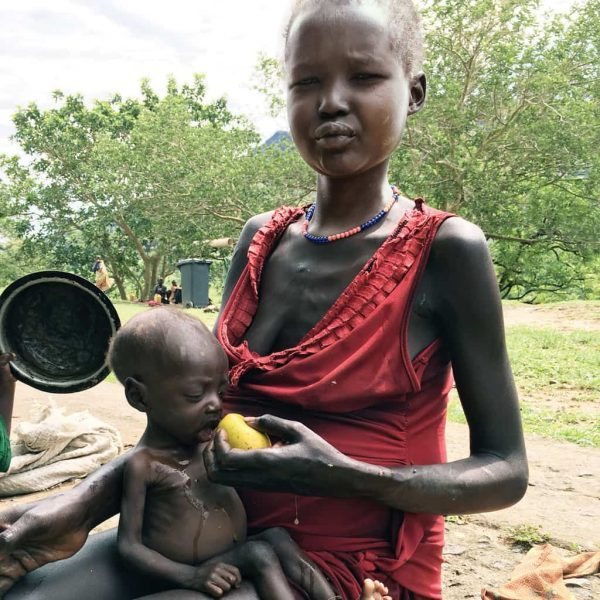 A malnourished mother and child receive help at a feeding station in South Sudan.