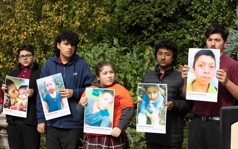 Young people exemplify mission in Chicago by participating in a prayer vigil calling for humane treatment for immigrant children such as those in the pictures they are holding, who died after being detained at the U.S. border. (Octavio Duran/U.S.)
