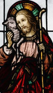Pandemic prayer: Jesus is depicted as the good shepherd in a stained-glass window at Blessed Sacrament Church in Bolton Landing, N.Y (CNS photo/Gregory A. Shemitz)