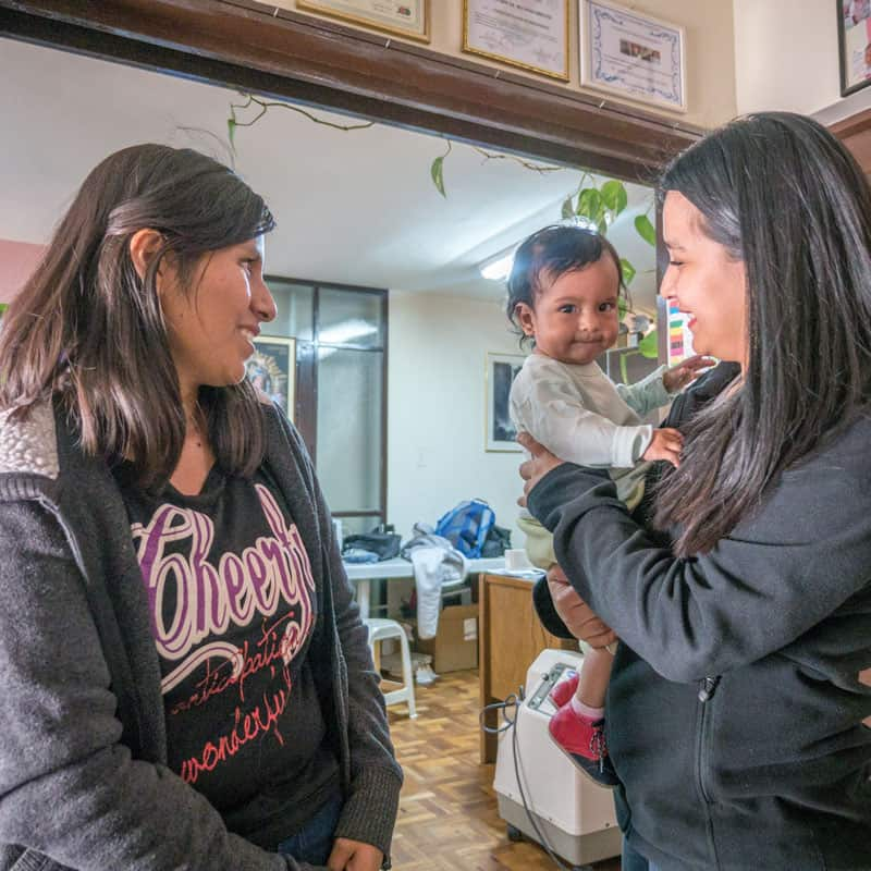 Solidarity bridge: Roxana Mamani (left) shares her story with Marizol Mamani (no relation), the social worker of Puente de Solidaridad holding Roxana's baby Ailee, who was diagnosed with a congenital heart disease. (Nile Sprague/Bolivia)
