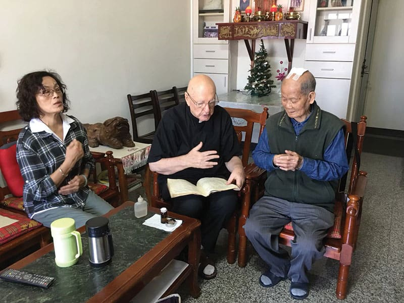 Father Murray and members of the Legion of Mary visit parishioners weekly in Taichung. The priest has served the people of his parish for 35 years. (Courtesy of Our Lady of China / Taiwan Church)