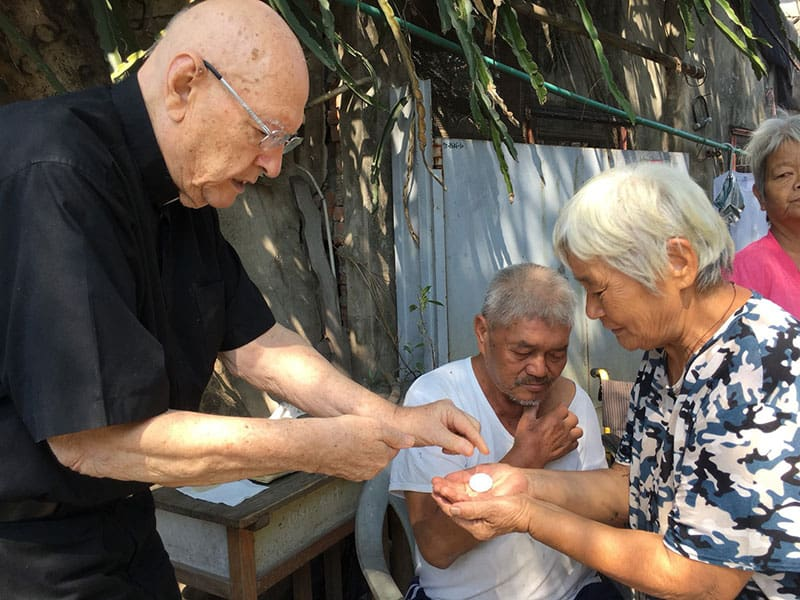 Father Murray visits elderly or sick parishioners at least three times a week, bringing the sacraments to them. (Courtesy of Our Lady of China / Taiwan Church)