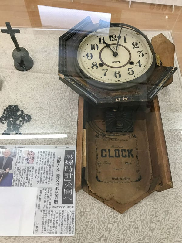A broken clock stopped by the Aug. 9, 1945, atomic bombing of Nagasaki, Japan, as well as a burned cross and rosary are pictured at the Urakami Kirishitan Museum in Nagasaki, Japan, Aug. 29, 2017. (CNS photo/Mihoko Owada)