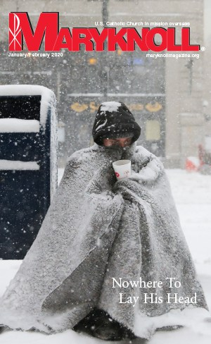 A homeless man appeals for money during blizzard-like conditions in Boston. CNS/Brian Snyder, Reuters/U.S.