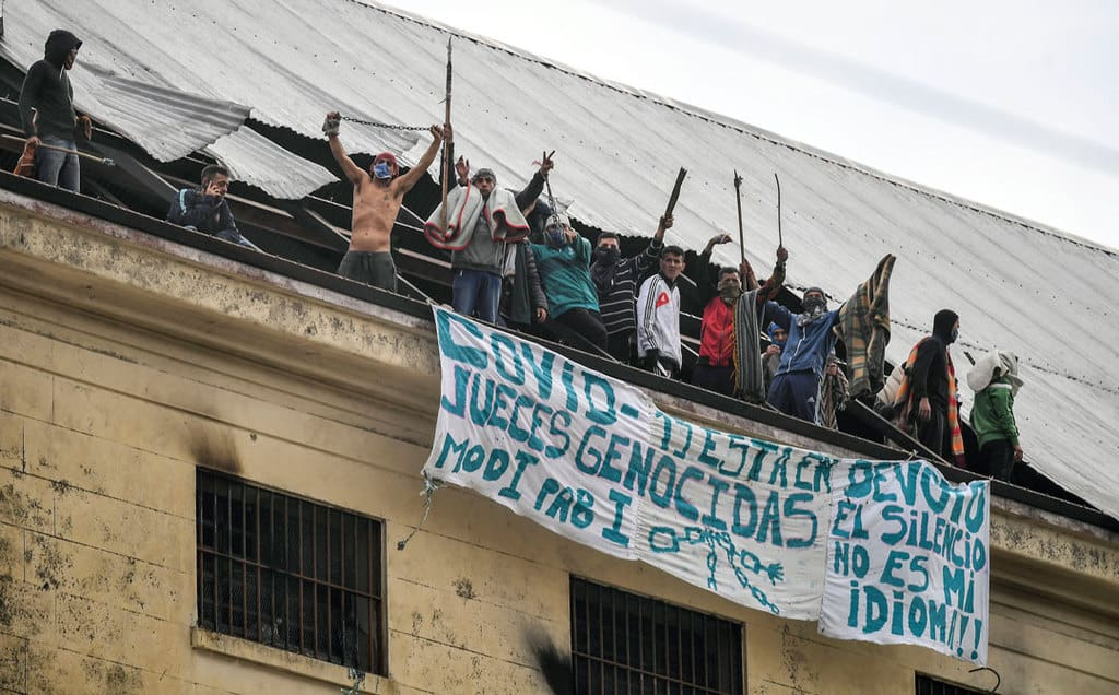 Prisoners protest in late April on the roof of the Devoto prison in Buenos Aires, Argentina, demanding action on overcrowding during the COVID-19 pandemic. (CNS photo/Victor Carreira, Latin America News Agency via Reuters)