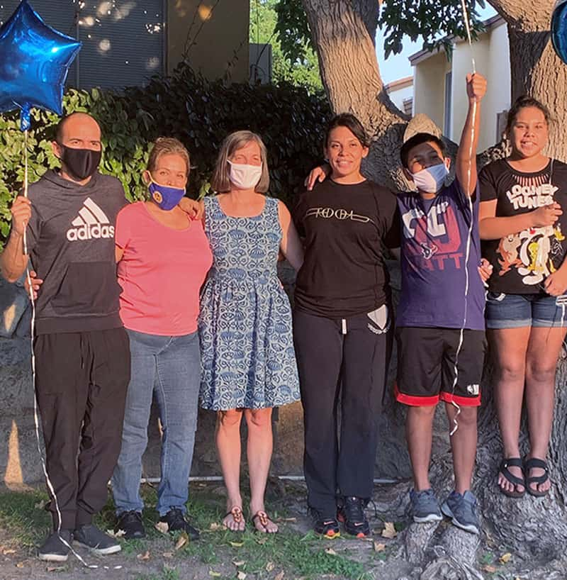 Elizabeth (third from right) is finally home with her family and Heidi Cerneka (Courtesy of MKLM)