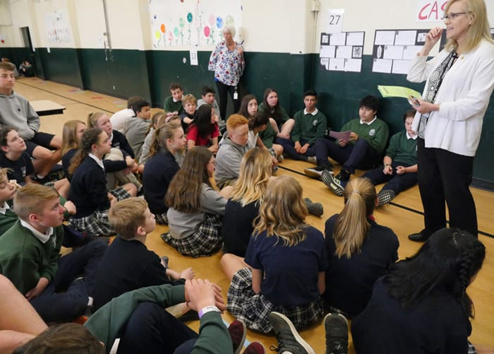 Sandra Barton Smith, of the Seattle Archdiocese, shares what it means to be a missionary disciple beyond middle school, as teacher Mari Halley looks on. (Peter Saunders/U.S.)