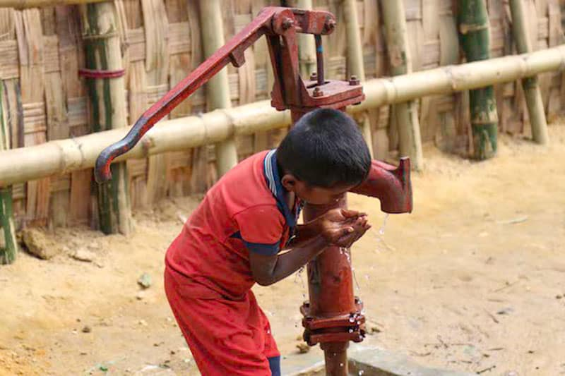 A Rohingya child drinks water from a tube well at Balukhali refugee camp in 2017. (Photo: Stephan Uttom/UCA News)