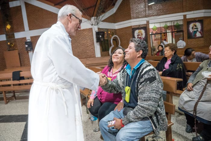 Father Chapin greets Bolivian parishioners in a photo taken before COVID-19.
