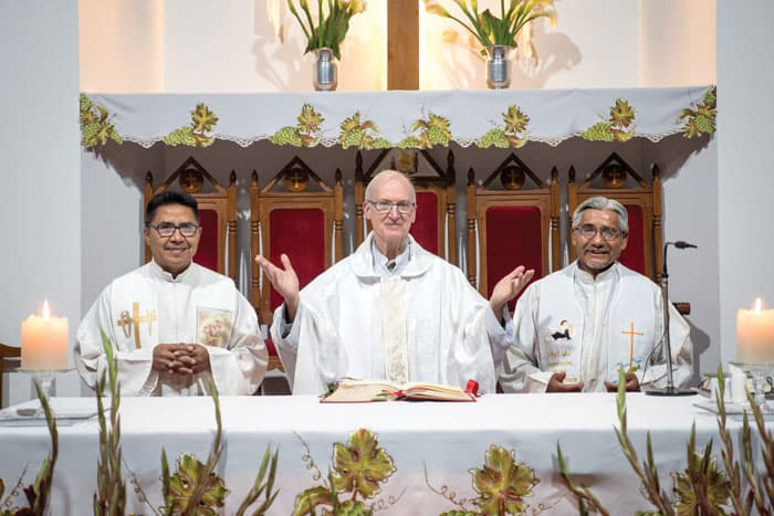From left to right: Father David Cardozo, pastor of Our Lady of La Salette parish; Father Daniel Chapin and Father Cruz are ready to celebrate  Mass. (Nile Sprague/Bolivia)