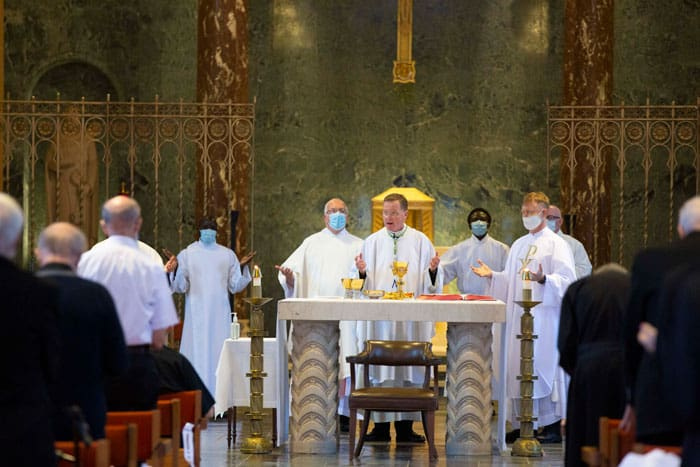 Bishop Edmund J. Whalen of New York (center) during the consecration at Gregory McPhee's ordination Mass, held at Our Lady of the Apostles Chapel in Maryknoll, N.Y. (Octavio Duran/U.S.)