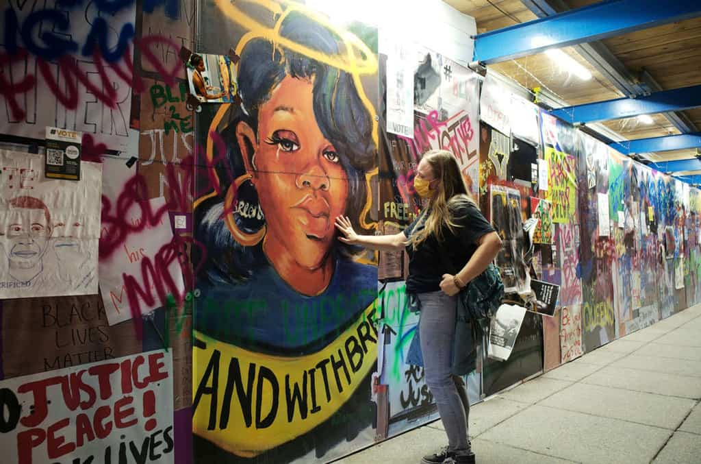 A woman in Washington touches a Breonna Taylor mural at Black Lives Matter Plaza on Sept. 24, 2020. (CNS/Cheriss May, Reuters)