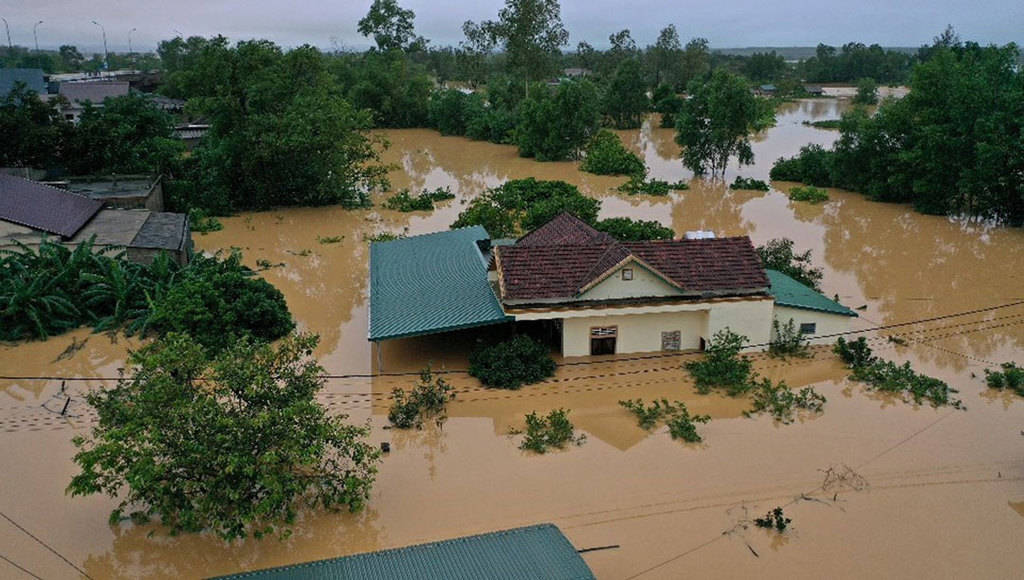 Floodwaters surround a home in Vietnam's province of Quang Tri Oct. 18, 2020. Two dioceses in central Vietnam hit by some of the worst floods in the country's history are struggling to provide emergency aid for hundreds of thousands of victims. (CNS/Ho Cau, VNA handout via Reuters)