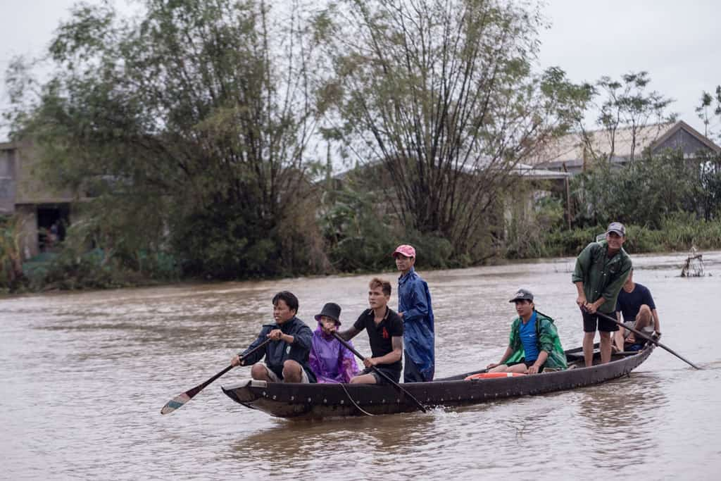 Local residents row a boat to a pickup point for delivering aid packages to residents affected by flooding in Thua Thien Hue province, Vietnam, Oct. 20, 2020. Two dioceses in central Vietnam hit by some of the worst floods in the country's history are struggling to provide emergency aid for hundreds of thousands of victims. (CNS/Yen Duong, International Federation of the Red Cross handout via Reuters)