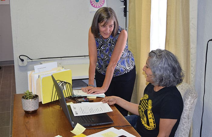 Maryknoll Lay Missioner Heidi Cerneka (left), attorney, consults with paralegal Connie Lara at Las Americas Immigrant Advocacy Center in El Paso, Texas, where the pair offers legal aid to migrants on the U.S.-Mexico border. (Meinrad Scherer-Emunds/U.S.)