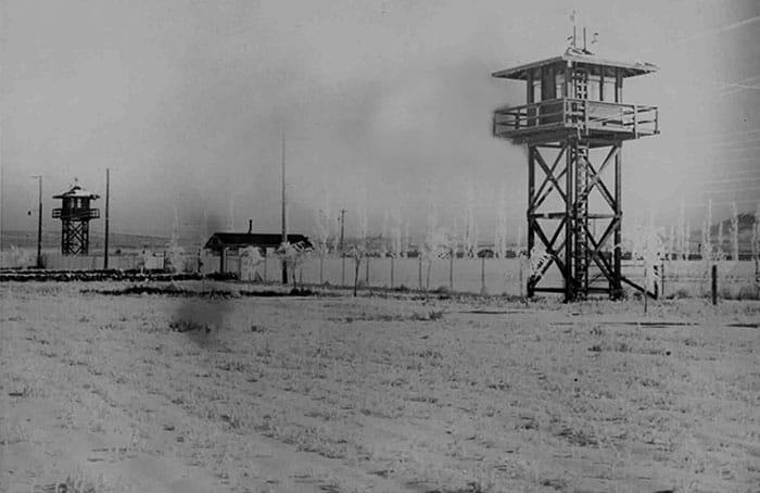 Tule Lake Segregation Center, the last of the relocation centers to close, in 1946, was surrounded by barbed wire fencing and guarded from towers by soldiers with guns. (Courtesy of Helen Parra)