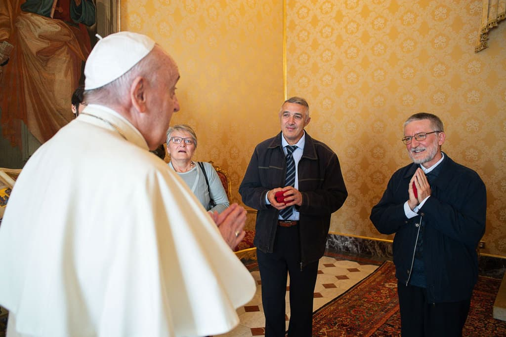 Pope Francis meets Father Pierluigi Maccalli, right, and members of the priest's delegation at the Vatican Nov. 9, 2020. Italian Father Maccalli, a priest of the Society of African Missions, and three other hostages were released Oct. 8 after being kidnapped and held for more than two years in Niger and Mali. (CNS/Vatican Media)