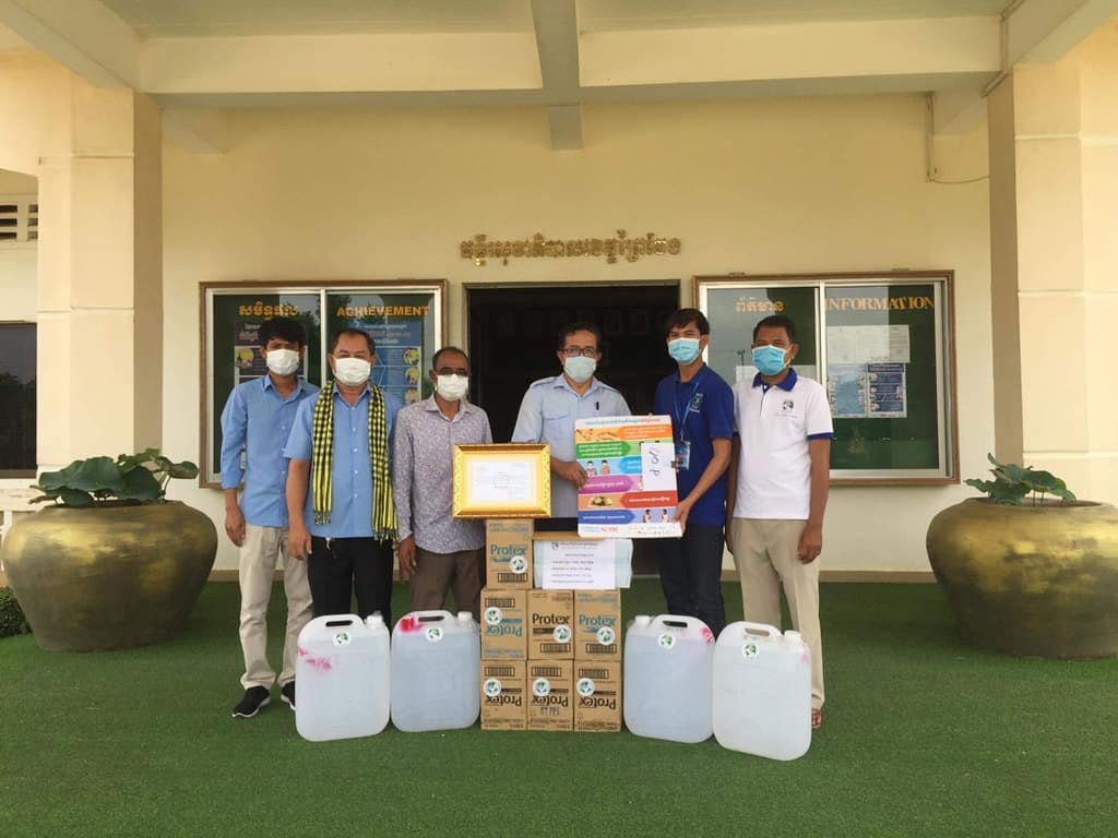 Members of Father Conroy's mental health team deliver personal protective equipment to the Provincial Department of Health in Prey Veng Province, about two and a half hours from Phnom Penh, capital of Cambodia. (Courtesy of Keven Conroy/Cambodia)