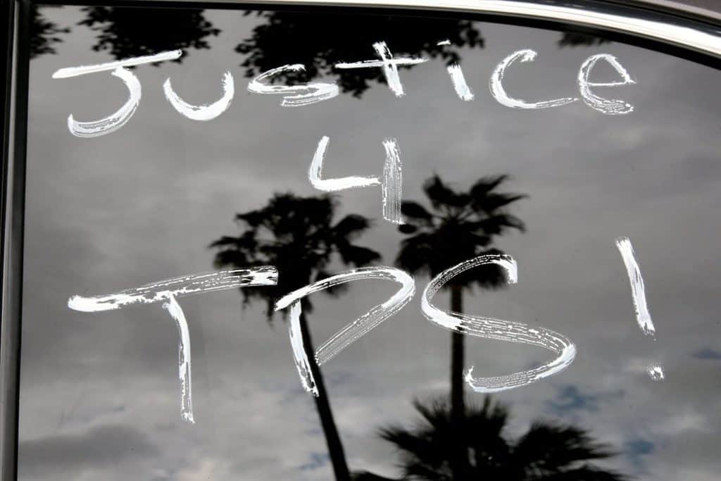 """""""Justice 4 TPS"""" is seen Oct. 3, 2018, on a car window in Los Angeles, a rallying cry to protect the Temporary Protected Status program. (CNS photo/Kyle Grillot, Reuters)"""