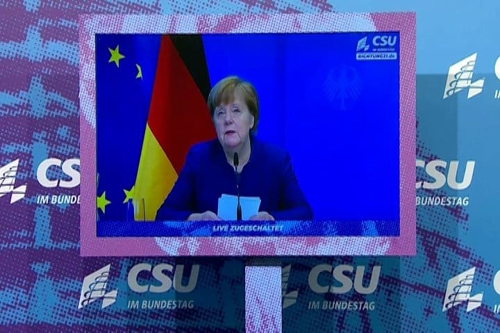 """German Chancellor Angela Merkel speaks on television during an address in Berlin Jan. 7, 2021, during which she commented on the storming of the U.S. Capitol in Washington by supporters of U.S. President Donald Trump. Merkel said photos of the mob intruding into the Capitol made her angry and sad but that """"democracy is stronger than the attackers and rioters."""" (CNS photo/Reuters)"""