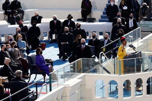 Amanda Gorman recites a poem at the U.S. Capitol Jan. 20, 2021, during the inauguration of Joe Biden as the 46th president of the United States. She is a parishioner at St. Brigid Catholic Church in Los Angeles. (CNS photo/Brendan McDermid, Reuters)