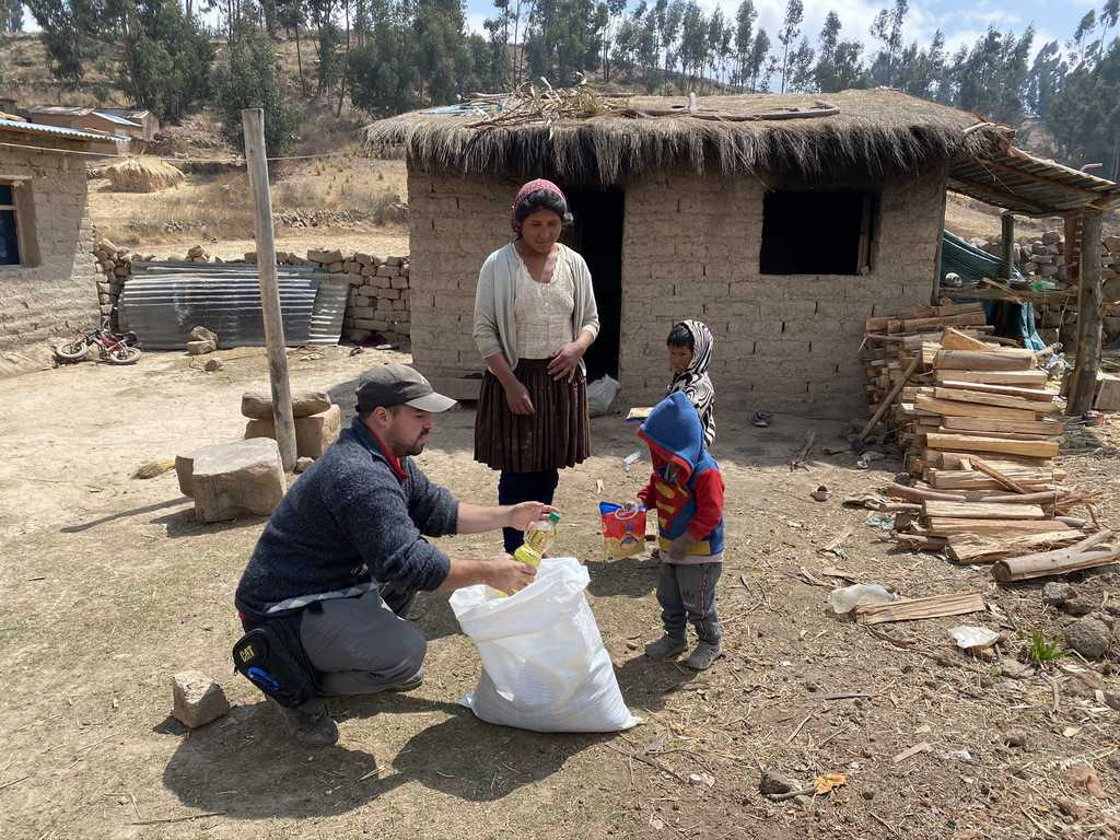 Maryknoll Lay Mission Juan Gomez helps delivers aid to an indigenous family in a village outside of Cochabamba, Bolivia, where the missioner and staff from the Maryknoll Mission Center there distributed food in response to the COVID-19 pandemic.