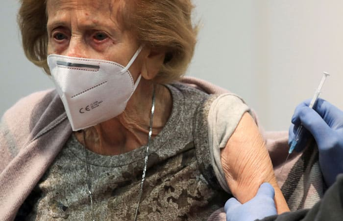 Elisabeth Steubsand, 105, receives a dose of the Pfizer-BioNTech COVID-19 vaccine, at a vaccination center temporarily set up in a fair hall in Cologne, Germany, Feb. 8, 2021. (CNS photo/Wolfgang Rattay, Reuters)