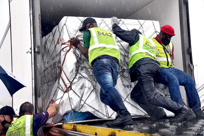 Workers load South Africa's first COVID-19 vaccine doses as they arrive at O.R. Tambo International Airport in Johannesburg Feb. 1, 2021. (CNS photo/Elmond Jiyane, GCIS handout via Reuters)