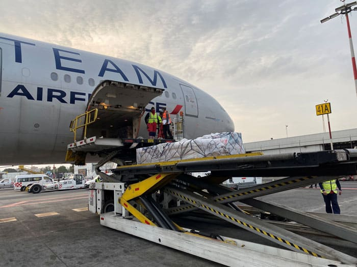 Workers unload a batch of the first shipment of doses of the COVID-19 vaccine by German biotech firm CureVac that arrived for Phase III clinical trials at Benito Juarez International Airport in Mexico City Jan. 27, 2021. (CNS photo/Mexico's Foreign Ministry handout via Reuters)