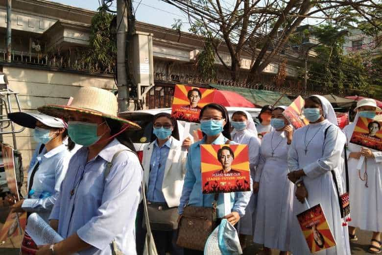 Catholic nuns holding images of ousted leader Aung San Suu Kyi recite prayers and the rosary during a peaceful protest in Yangon on Feb. 21, 2021. (Photo: Good Shepherd Myanmar)