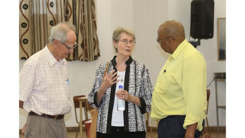 At the launch of the book The Scourge of Human Trafficking: Modern-Day Slavery, editor Sister Janice McLaughlin converses with E. Geoghegan (left), AFCAST financial advisor, and Z. Godi, a member of the AFCAST Working Group to Combat Human Trafficking. (Courtesy of AFCAST/Zimbabwe)