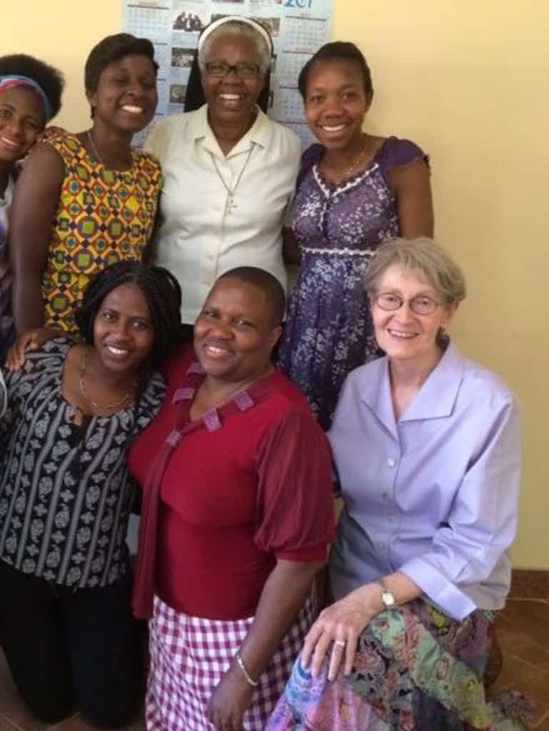 Survivors of human trafficking pose with Maryknoll Sister Janice McLaughlin (seated, right), Dadirai Chikwekwete (red blouse) and Dominican Sister Tendai Makonese (white blouse), the director of Lifelines, a media production company, during the recording Sister Makonese directed of a short video on human trafficking that is on the AFCAST website. (Courtesy of AFCAST/Zimbabwe)