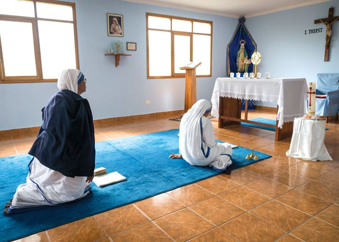 Sister Adelbert (left) and another Missionaries of Charity sister share a time of prayer and reflection in their small private chapel at the center where Lay Missioner John O'Donoghue serves. (Nile Sprague/Bolivia)