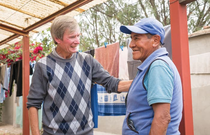 O'Donoghue walks around the home to check on the patients. Here he is talking and joking with Justo in the outside washing area at the center. (NIle Sprague/Bolivia)