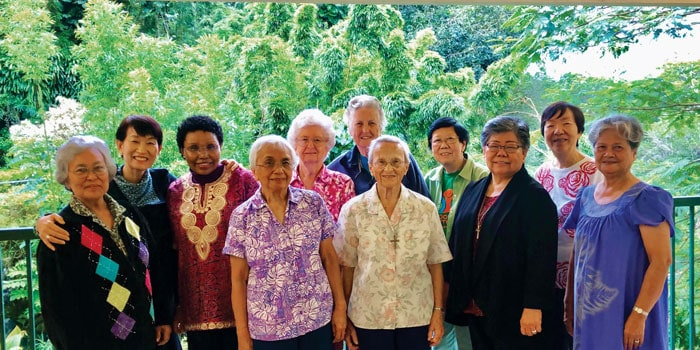Sister Ardis Kremer (back, center) poses with members of the Maryknoll Sisters congregation who were serving in Hawaii. (Courtesy of the Maryknoll Sisters)