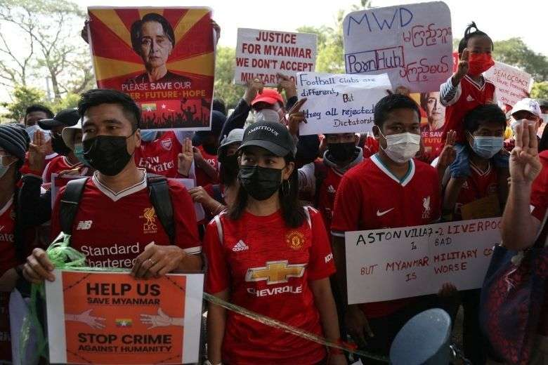 Myanmar Premier League football fans take part in a protest against the coup in Yangon on Feb. 12. (Photo: STR/AFP)