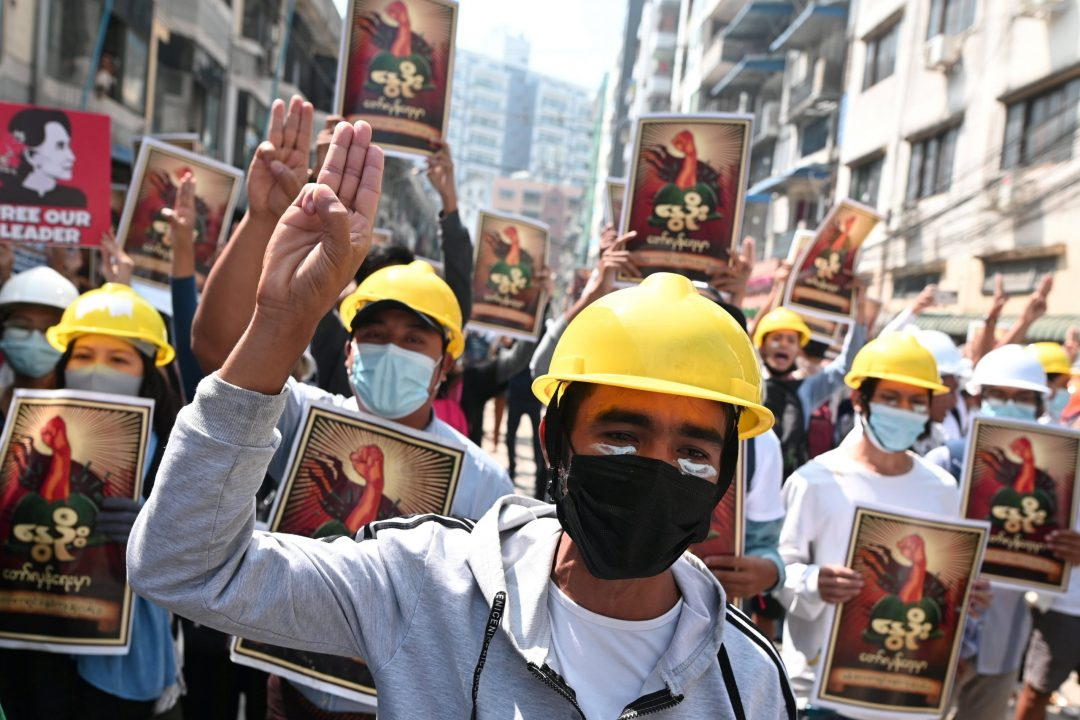 Demonstrators flash the three-finger salute March 1, 2021, during a protest against the military coup in Yangon, Myanmar. (CNS photo/Reuters)