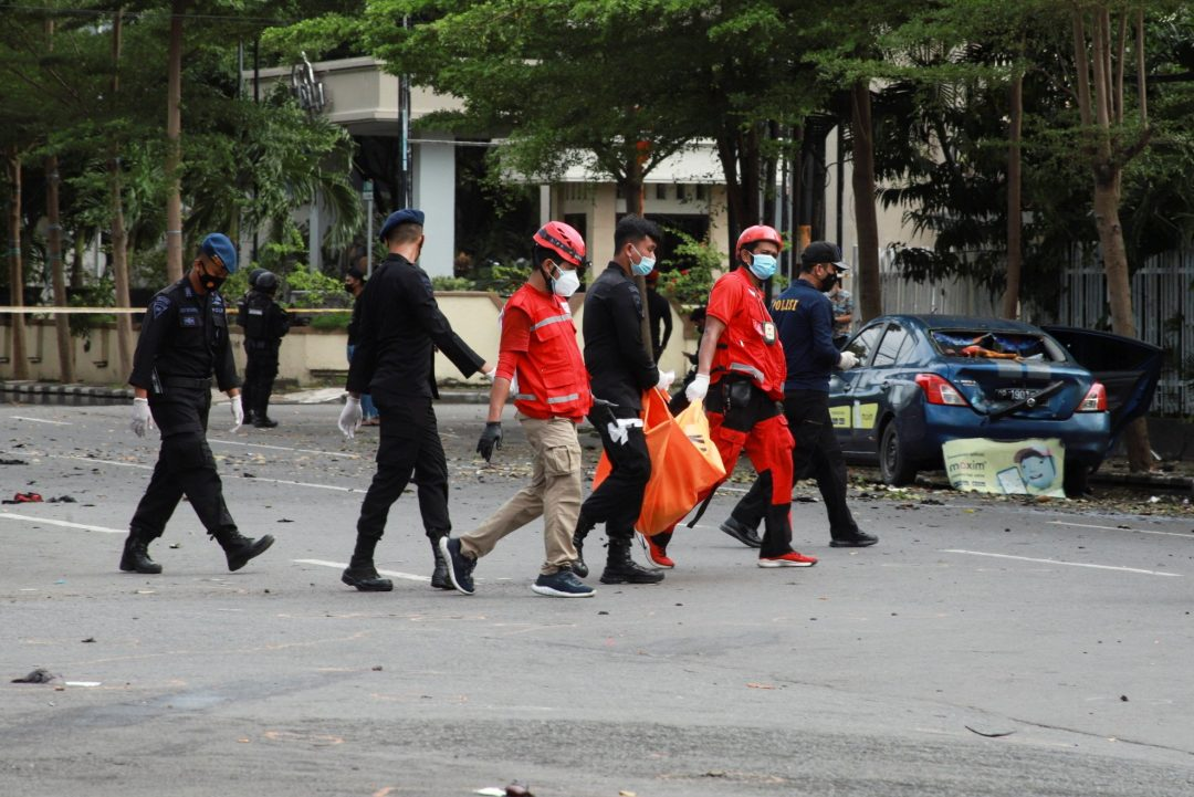 Indonesian Red Cross personnel carry a body bag following a suicide bomb attack during Palm Sunday Mass at Sacred Heart of Jesus Cathedral in Makassar, Indonesia, March 28, 2021. The two bombers died in the attack, and about 20 people were injured. (CNS photo/Reuters)