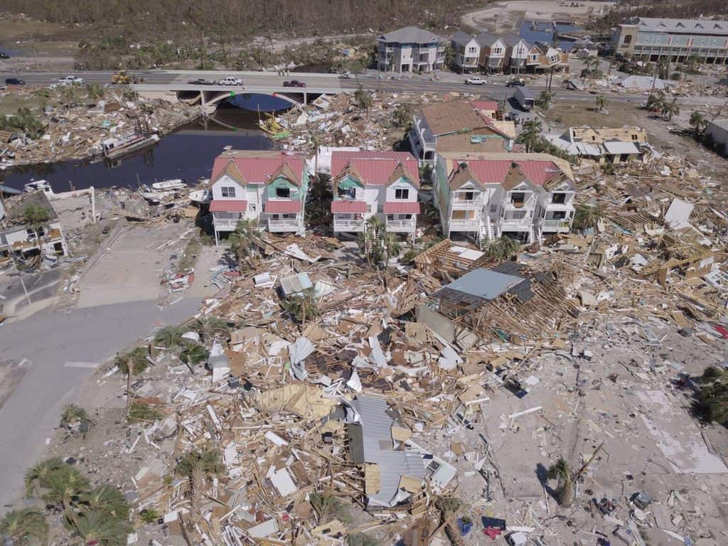An aerial photo shows damaged and destroyed homes after Hurricane Michael smashed into Florida's northwest coast in Mexico Beach, Florida, in this October 12, 2018, file photo. Many climate scientists have associated an increased number of natural disasters and their severity with climate change. (CNS photo/Dronebase, Reuters)