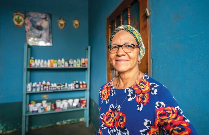 Angelina Enamorado at her home that also serves as a drop-in medical clinic and store in Barrio Chamelecón, a neighborhood of San Pedro Sula, Honduras. (Gregg Brekke/Honduras)