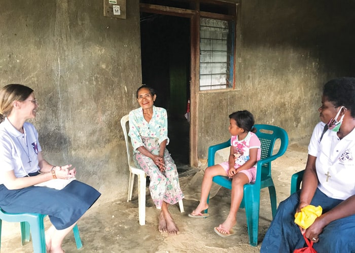 Maryknoll Sisters Julia Shideler (left) and Susan Wanzagi (right) visit homes and listen to the concerns of their neighbors in Aileu. (Courtesy of Susan Wanzagi/East Timor)