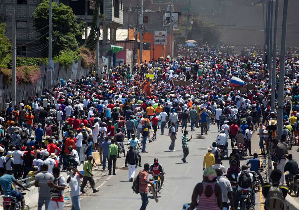 Demonstrators march during a protest against the government of Haitian President Jovenel Moïse in Port-au-Prince March 28, 2021. (CNS photo/Estailove ST-Val, Reuters)