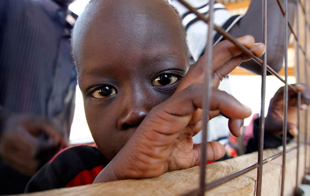 A child from South Sudan is pictured in a 2012 photo at a registration center in the Kakuma refugee camp in northern Kenya. Catholic bishops in Kenya are urging the government to shelve plans to close Dadaab and Kakuma refugee camps that host refugees who fled civil war and famine in Somalia and South Sudan. (CNS photo/Thomas Mukoya, Reuters)