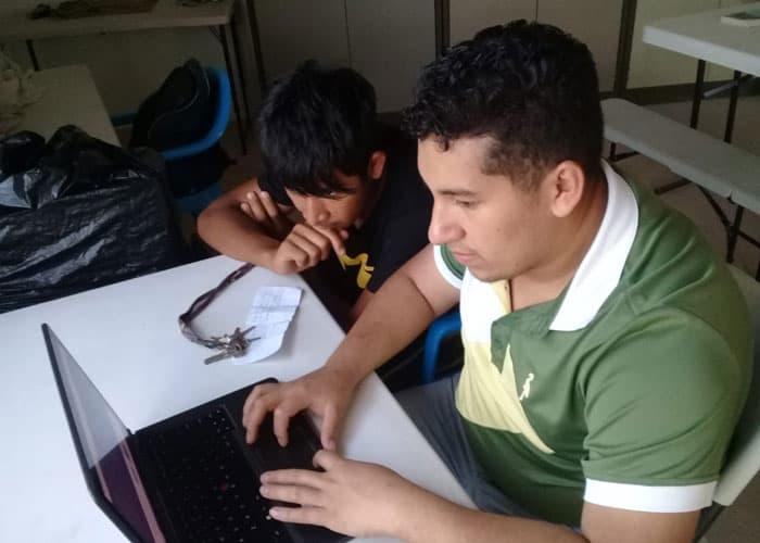 Luis Miguel helping Jefferson with homework (Courtesy of MKLM/El Salvador)
