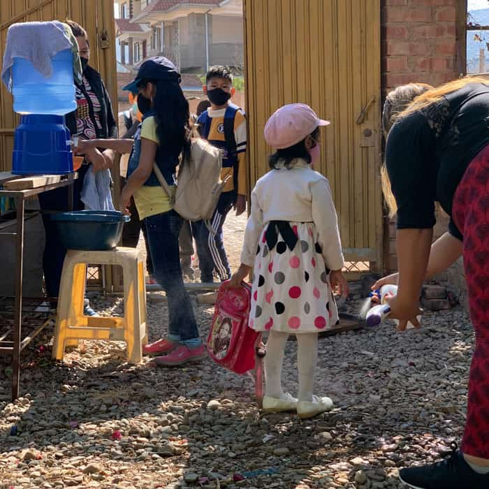 Students go through daily routine of biosecurity in Nueva Vera Cruz. The educators said that this routine became an opportunity to greet and talk with the children about their family. (Matthew Sim/Bolivia)
