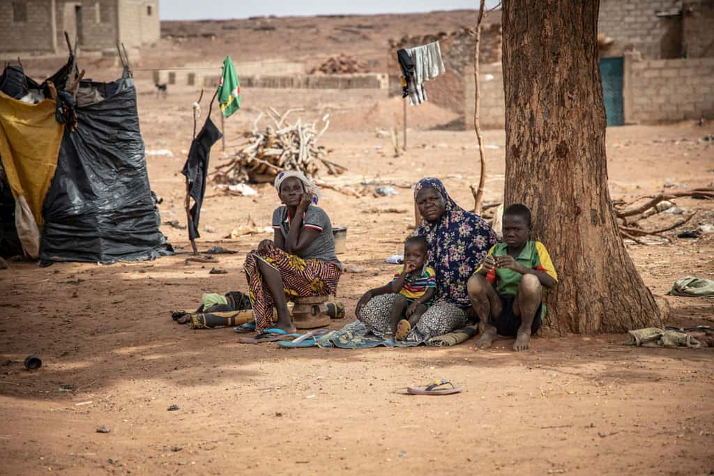 Displaced women and children rest in the shade in Kaya, Burkina Faso, June 4, 2020. Catholic and Muslim leaders are working jointly to deter youth from terrorist violence in Africa's Sahel region. (CNS photo/Olympia de Maismont for Catholic Relief Services)