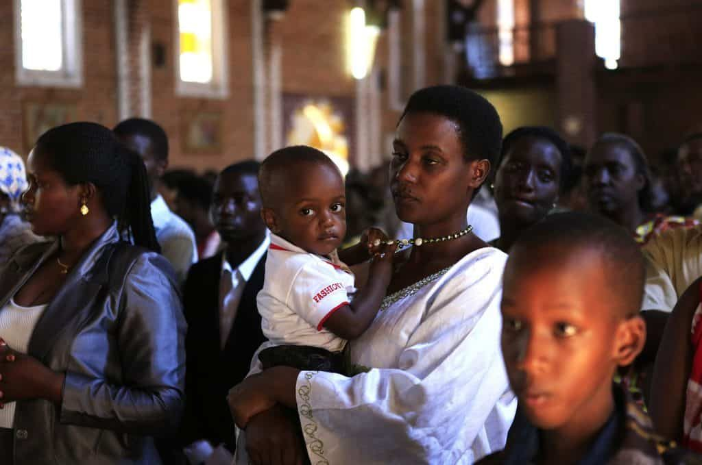 A family attends Mass in 2014 at a Catholic church in Kigali, Rwanda, where Christianity is growing.. The Rwandan bishops' conference urged steps be taken to ensure religious freedom after the government closed thousands of churches.(CNS photo/Noor Khamis, Reuters) See RWANDA-CHURCHES-RELIGIOUS-FREEDOM Aug. 14, 2018.