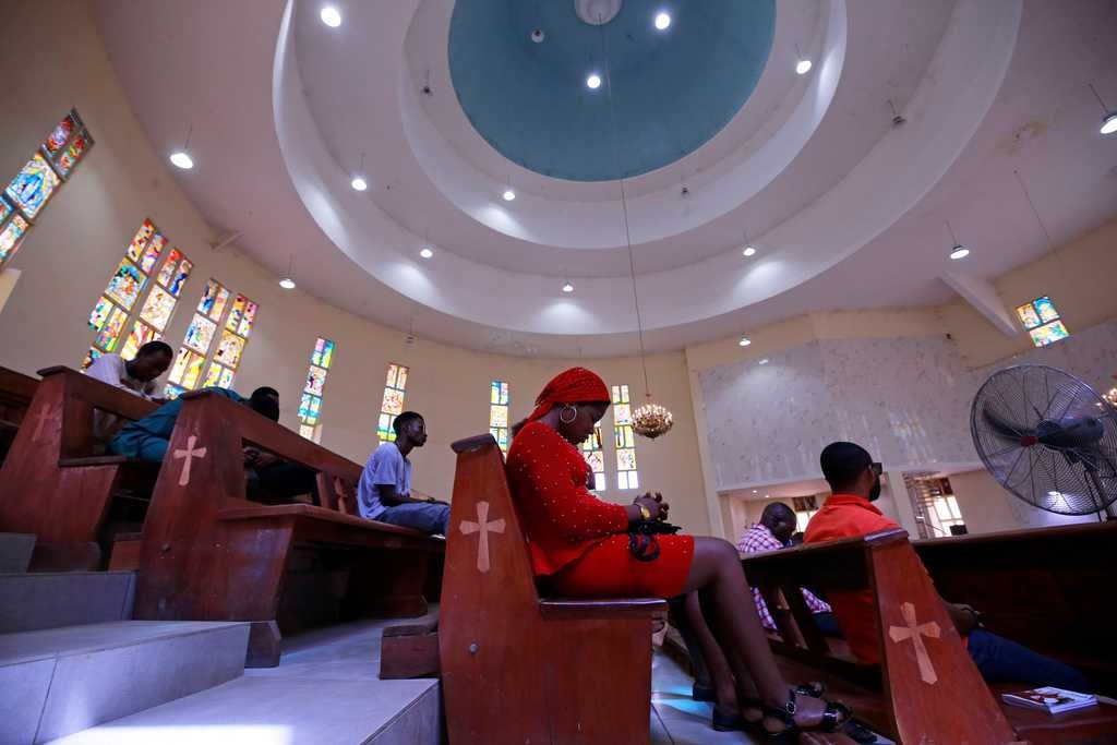 Worshippers pray during a March 22, 2020, Mass at St. Gabriel Catholic Church, in Abuja, Nigeria, as African governments struggle to control the spread of the coronavirus (COVID-19). (CNS photo/Afolabi Sotunde, Reuters)